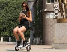 Oh what fun it is to ride in the saddle-equipped electric walkcar.